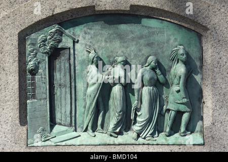 Hannah Duston kidnapped by Indians, bas-relief on a memorial in Haverhill,  Massachusetts. Digital photograph - Stock Photo