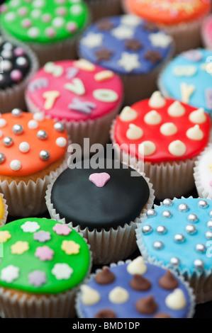 Colourful mini cupcakes - Stock Photo
