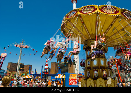 Visitors take advantage of the rides in Luna Park in Coney Island in the Brooklyn borough of New York on Memorial - Stock Photo