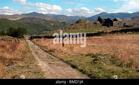 View north along old coach road from Beckstones to Millbrow, near Ulpha. Ruined hunting lodge, Frith Hall. Lake - Stock Photo