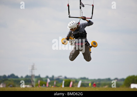 Middle Wallop Kite festival 2010, Kite landboarding and buggying on airfield on summers day - Stock Photo