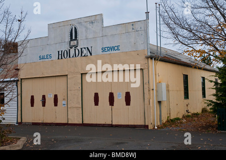 A General Motors Holden garage with original GMH logo circa 1960 in the historic village of Ross in the Tasmanian - Stock Photo
