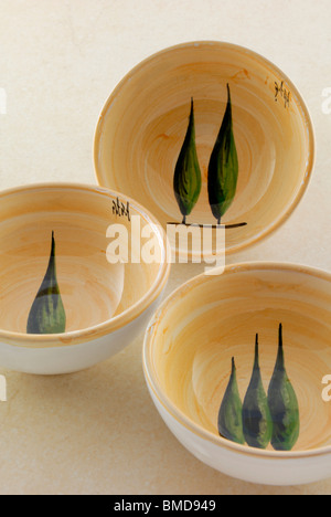A ceramic pottery decorated with the symbol of Tuscany, a cypress tree. Artista Artigiano Ceramic shop in Via San - Stock Photo
