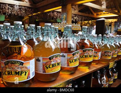 flagons of cornish scrumpy cider for sale in a farm shop near truro,cornwall,uk - Stock Photo