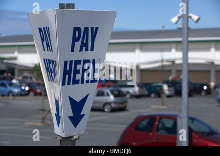 pay here sign at a pay and display car park in the uk - Stock Photo
