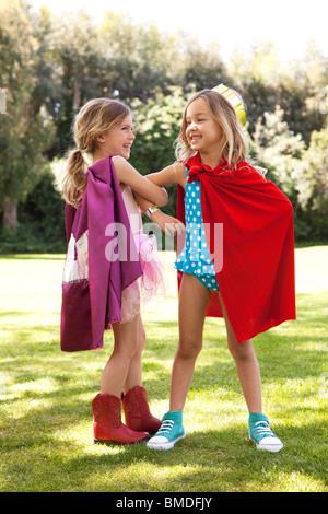 Girls in capes having fun - Stock Photo
