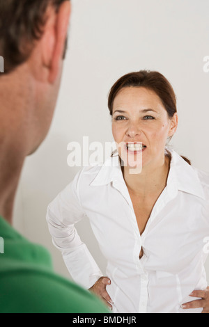 Angry Woman Confronting Man - Stock Photo