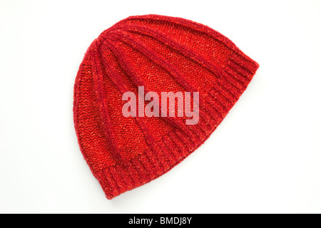 Red warm woolen beanie hat isolated on a white background - Stock Photo
