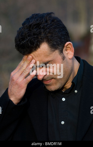 Portrait of a Middle Eastern man head in hands Berlin Germany - Stock Photo