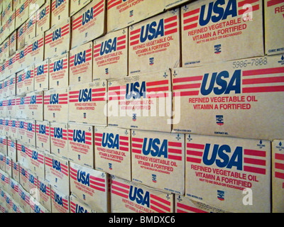 Mountains of vegetable oil donated by the USA lie in a World Food Program warehouse in Gonaives, Haiti - Stock Photo
