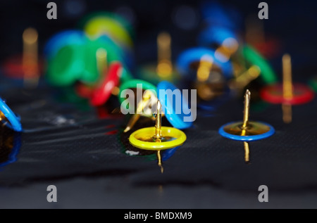 Extremely close-up macro photo of the pushpins in the water. Shallow depth of field and vibrant color for natural - Stock Photo