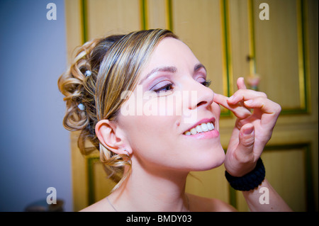 Portrait close-up of woman smiling after make-up and hairstyling - Stock Photo
