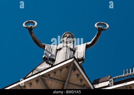 Statue holding laurels by Otto Wagner, Österreichische Postsparkasse (Austrian Postal Savings Bank) building, Vienna, - Stock Photo