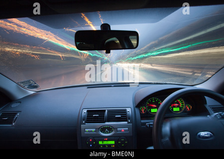 forward view from in side car as light trails streak by. long exposure - Stock Photo