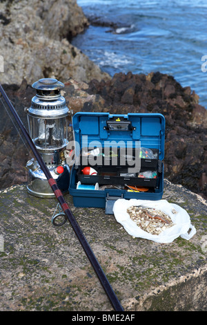 fishing tackle box filled with sea fishing gear and rod on the, Reel Combo