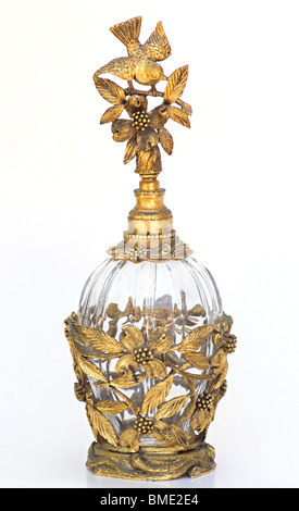 Gold & glass crystal figural vintage perfume bottle with bird and dogwood - Stock Photo