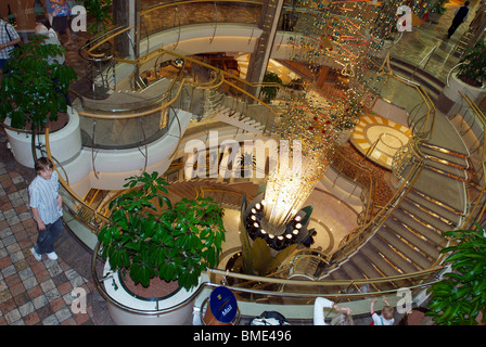 The Royal Caribbean cruise liner the Navigator of the Seas showing the massive main stairway aboard. - Stock Photo
