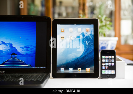16' Laptop, iPhone and Apple iPad compared in size,TouchscreenTablet Computer, Book Reader, Digital Ebook, Modern, - Stock Photo