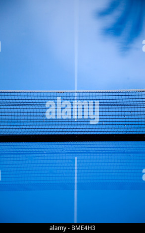 Abstract blue table tennis table in rain - Stock Photo