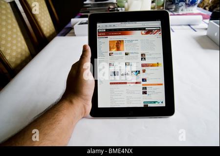 BBC News online on Apple iPad, TouchscreenTablet Computer, Book Reader, Digital Ebook, Modern, Logo, Brand, Luxury - Stock Photo