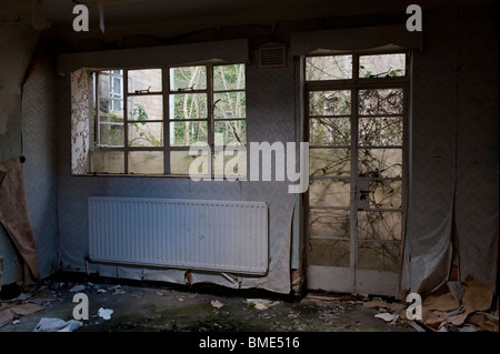 Hospital Room in a Derelict Psychiatric Asylum - Stock Photo