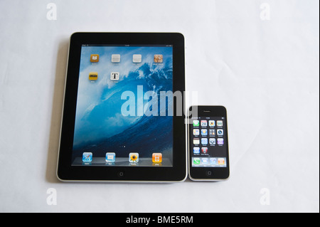 iPhone compared in size to Apple iPad, TouchscreenTablet Computer, Book Reader, Digital Ebook, Modern, Logo, Brand, - Stock Photo