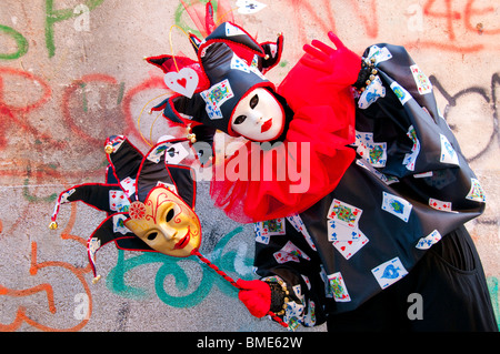 Venice Carnival, Italy, Costumed Jester joker participant - Stock Photo