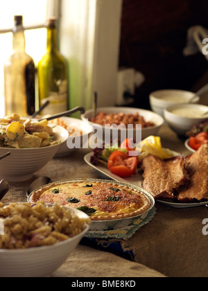 Varied food served at buffet - Stock Photo