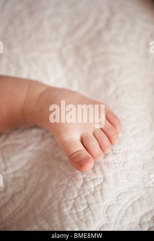 Babys toe on blanket - Stock Photo