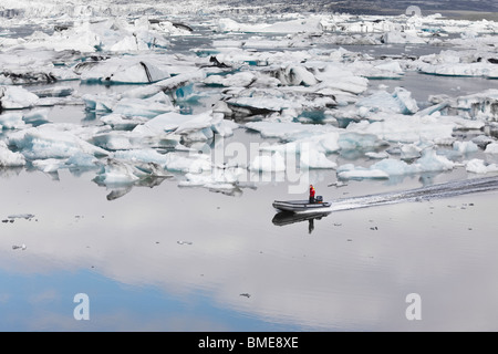 Boats in sea with ice around - Stock Photo