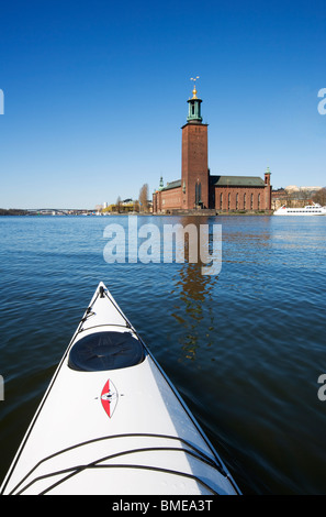 Kayak in front of the City Hall, Stockholm, Sweden. - Stock Photo