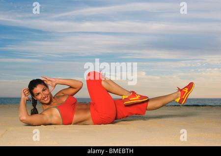 Woman exercising, smiling, portrait - Stock Photo