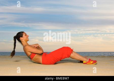 Woman exercising, smiling - Stock Photo