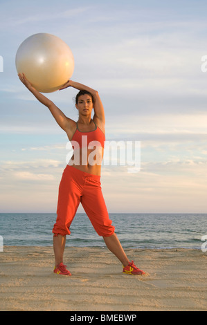 Woman exercising with fitness ball - Stock Photo