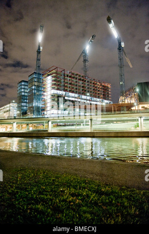 View of elevated road and building under construction at night - Stock Photo