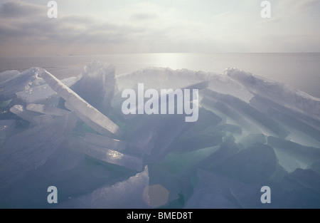 Ice floe with sea in background - Stock Photo