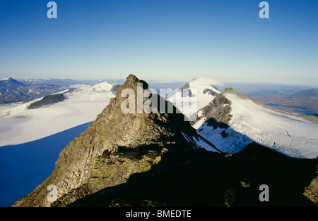 View of snow covered mountain peaks - Stock Photo