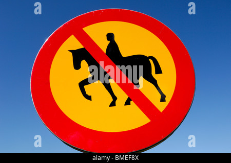 Scandinavia, Sweden, Vastergotland, Horse crossing sign against sky, close-up - Stock Photo