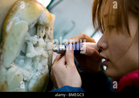 Master craftsman carving a jade art piece, Yangzhou, Jiangsu Province, China - Stock Photo