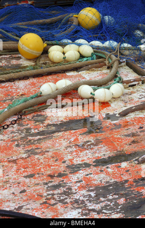 fishermen professional tackle net on boat aged grunge wooden wet deck - Stock Photo