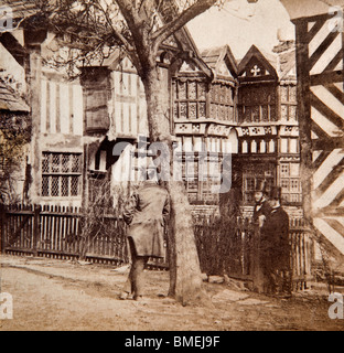 UK, England, Cheshire, Scholar Green, Little Moreton Hall in 1860s Victorian photograph by Peter Burgess - Stock Photo