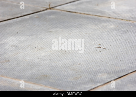 square concrete paving slab laid as a garden patio in the uk - Stock Photo