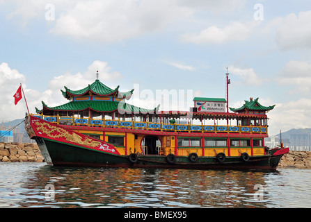 Side profile view of the traditional Chinese 'Phoenix Water Tour Boat', moored in the Causeway Bay Typhoon Shelter, - Stock Photo