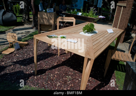Garden Furniture France wooden garden furniture table & chairs & sun shade umbrella stock