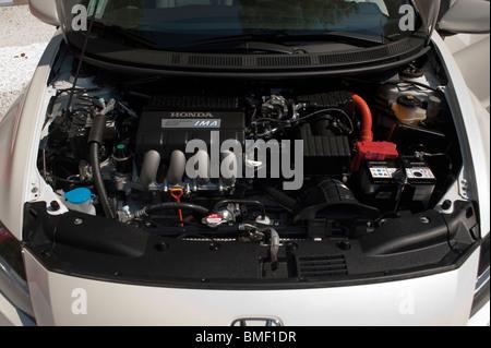 Japanese Hybrid Car on Display, Honda CR-Z, Open Boot, Showing Motor - Stock Photo