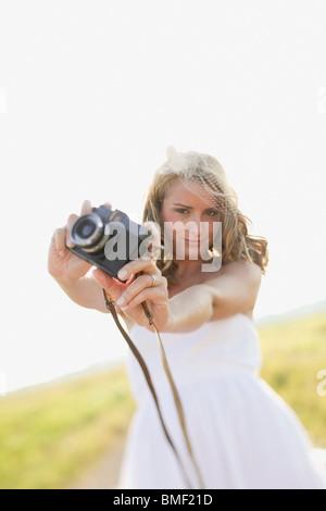 A Bride Holding A Camera - Stock Photo
