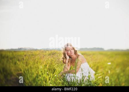A Bride In A Field - Stock Photo