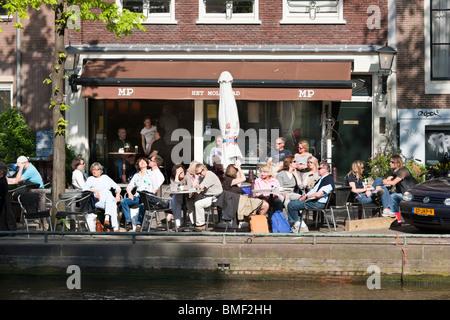 Amsterdam 'bar serving food' Het Molenpad. Outside sidewalk cafe terrace on the Prinsengracht Canal near Nine Little - Stock Photo