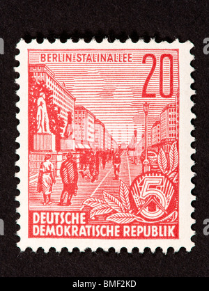 Postage stamp from East Germany (German Democratic Republic) depicting a street scene from Stalin Boulevard in Berlin. - Stock Photo