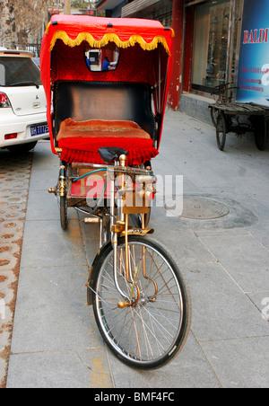 Richly decorated rickshaw, Beijing, China - Stock Photo